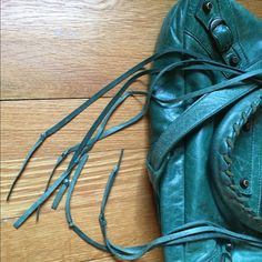 Extra Photos  Balenciaga Emerald First Bag  See primary listing for specs and photo of interior silver Y tag (S/S 2006). Mirror, detachable shoulder strap, and dust bag included. Pictured are authenticity markers (Lampo zipper logo and bales). This is a ten year old bag with noticeable wear but it has aged beautifully. Note that the tassels have been shortened and knotted at the ends, with the mirror tassels looped through the top zippered opening. Please ask questions before purchasing…