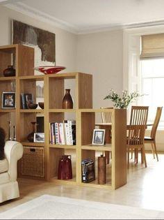 nichos separando sala de estar e sala de jantar: