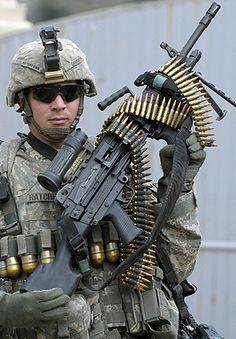 m249 mark 42... So Sweet. I'll take the warrior AND the weapon thank u very much! lol