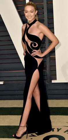 Gigi Hadid: Vanity Fair's Oscar After Party definitely saw some skin in the form of Gigi's pieced out Atelier Versace gown. | #Celebrity #Style