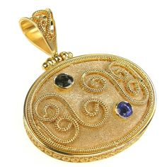 Damaskos Twin Sapphire Grand Circle Sided Medallion,18k Gold and 2 Sapphires (Blue and Dark Green Shown). You may choose your sapphire color. Athena's Treasures, www.athenas-treasures.com