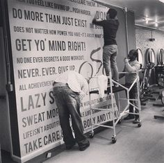 The Replica team installing a custom wall graphic at #BodyCycleStudios! #Philly #gym