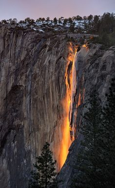 Horsetail Falls, Yosemite National Park  ---------------------------------------------------------  Every year, in the month of February, the sun's angle is such that it lights up 'Horsetail Falls' in Yosemite National Park as if it were on fire.