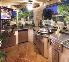 Inspiration Kitchen. Posh Outside Kitchen For Styles, Layouts And Decorations: Awesome Ceiling Lights Fan Over Stainless Steel Built In Gas Barbecue Grill With Open Views Outside Kitchen Design Ideas With Pillar Stones And Flooring Views