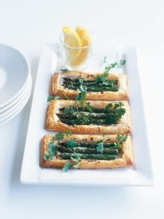 Asparagus and ricotta tarts! I truly believe asparagus belongs on every easter table. I am adding a  couple of recipes here to have lots to choose from.  I personally can not resist the combination of asparagus and puff pastry! yum.    To see all recipes please click here.    http://pfrdesign-inspiredliving.blogspot.ca/2012/03/delicious-easter-recipes.html