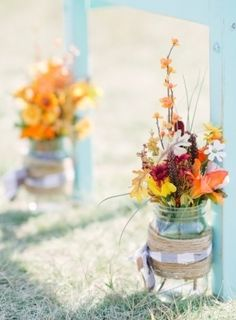 Colorful outdoor wedding decorations made from large mason jars. | {Milton Photography}