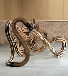 Wood shaped into a complex (but fluid) flow.