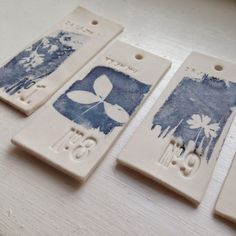 Hannah Lamb: porcelain labels for 'Linear Mapping' 2015 (installation)