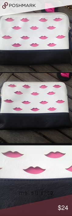 "Melie Bianco Catalina Lips Clutch This clutch is too cute to leave behind! Melie Bianco ""Catalina"" lips clutch is made of two layers of durable vegan leather- the top white layer is laser cut allowing the sweet pink under layer to playfully peep out! Satin polka dot lining pairs well with the black bottom and pull. Interior has 2 sections as well as a zippered pocket for safekeeping. Nearly new-EUC. 10.5""x 8"". I'll include the matching compact with purchase 😘 Feel free to ask questions…"
