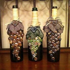 Altered Bottles - use a wine bottle, flat marbles, twine and fabric leaves to create grapes! Wine Bottle Art, Wine Bottle Crafts, Bottle Wall, Vodka Bottle, Wine Cork Art, Crafts To Make, Diy Crafts, Recycled Crafts, Handmade Crafts