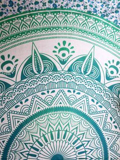 Turquoise & Green Ombre Mandala Tapestry, comprising of floral inspired patterns in striking shades of turquoise and light greens in ombre shading.