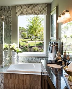 An incredible view right from your master #bathroom with an oversized #bathtub, #tiled #backsplash, dual #vanity #sinks, and a #glass walk-in #shower. #dreambathroom #design
