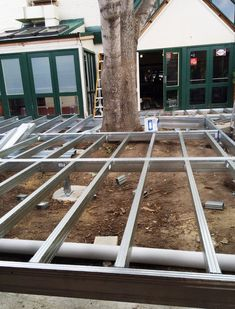 Steel framed deck being installed low to the ground around a big old tree at Mittagong Hotel. This will be the new beer garden and dining area for guests to stroll out onto through the French doors.