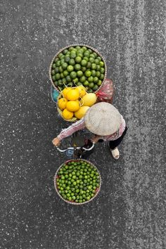 """Loes Heerink is a talented self-taught photographer and communication officer based in Enschede, Netherlands. For her photo series """"Vendors from Above"""", Loes has spent days on bridges to capture th…"""