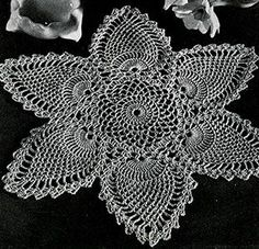 Doily #7768-A crochet pattern originally published in Pineapple Designs, Spool Cotton Co #230.