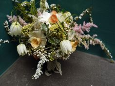 Seasonal spring bouquet of white snake's head fritillary, daffodils, and lily of the valley from www.pyrusflowers.co.uk