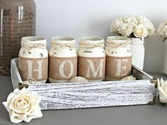This is a custom designed & hand-painted set of 4  pint size Mason Jars wrapped in burlap to spell out...