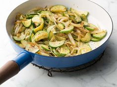 Melissa sautées zucchini and onions until they're slightly caramelized to bring out the veggies' sweetness.