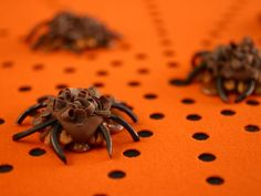 Caramel-covered nut clusters turn into spiders with the help of licorice legs.
