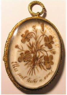 Gold locket with floral design of lacquered hair from Napoleon. This is one of many artefacts stolen in a major theft of Napoleonic memorabilia from The Briars Homestead at Mount Martha, Victoria, Australia. Please visit the link from which this image is taken to see the other missing items, and share the images to help aid in the items' recovery. Thanks.