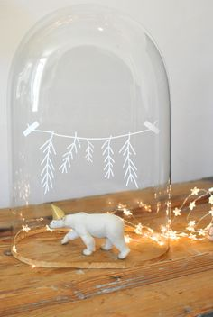 Polar bear in a cloche! Use glass pen & snow in base. Made this with a cheese board & papier mache bear that I sprayed white!