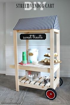 A DIY tutorial to build a kids street vendor cart with link to free plans. #WoodworkingPlansForKids