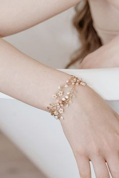 Subtle hues of pink, blush and gold are the features of our handmade bracelet with cherry blossom inspired flowers, freshwater pearls and gold leafy vines that turn into an intricate and delicate piece of jewelry. Fancy Jewellery, Stylish Jewelry, Cute Jewelry, Wedding Jewelry, Wedding Bracelets, Bridal Bracelet, Flower Bracelet, Ring Bracelet, Jewelry Design Earrings