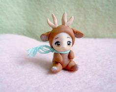 Tiny deer doll - OOAK miniature figurine with jointed neck. $42.00, via Etsy.