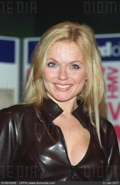 GERI HALLIWELL British Pop Singer Seen launching her new single 'Lift Me Up' at the HMV store in London's Oxford Street. COMPULSORY CREDIT: UPPA/Photoshot Photo UIW 016751/A-11 01.11.1999 - stock photo Geri Halliwell, Vinyl Clothing, Blonde Model, Oxford Street, British Actresses, Spice Girls, Pop Singers, Female Bodies, Good Music