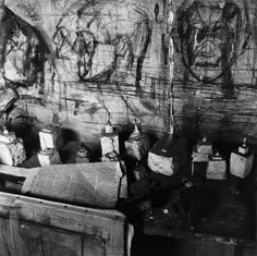 Planar drawings of heads on a wall of alberto giacometti's studio.