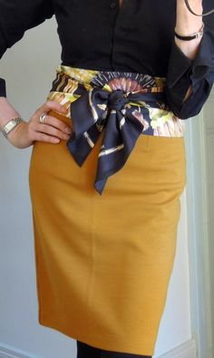 Silk Scarf tied as a belt. If only I could figure out how to do this! I like the shape of the skirt too, but not the color.