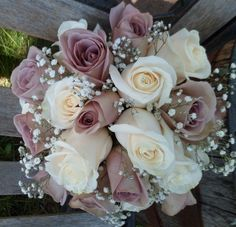 Bridal bouquet: amnesia and cream colored roses with baby's breath.