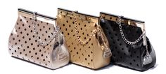 Nothing better than silver and gold!  The Diamond Girl line in Napa leather with diamond cuts.  www.glasshandbag.com