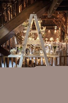 Ladder Decor Photos Fairy Lights Cosy Winter Barn Wedding kerryannduffy.com/ #weddings #wedding #marriage #weddingdress #weddinggown #ballgowns #ladies #woman #women #beautifuldress #newlyweds #proposal #shopping #engagement