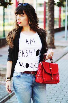 "Outfit: ""I am a fashion blogger"" t-shirt; black blazer; sunglasses; jeans; red camera bag; kitty flats"