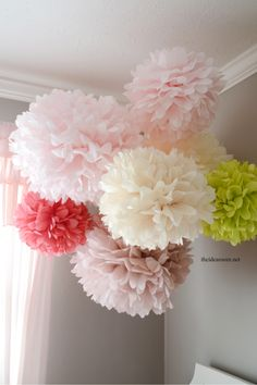 Tissue Paper Pom Poms Tutorial At the end of the top of the wire be sure to make a loop. This is where you will attach the fishing line to hang the pom pom from the ceili The post Tissue Paper Pom Poms Tutorial appeared first on Diy Flowers. Tissue Paper Crafts, Tissue Paper Pom Poms Diy, Tissue Paper Decorations, Diy Paper Lanterns, Pom Pom Decorations, Paper Crafting, Room Decorations, Diy And Crafts, Crafts For Kids