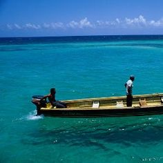 Top 10 Jamaica travel experiences A fishing boat motors on clear waters off Jamaica. Jamaica Vacation, Jamaica Travel, Vacation Spots, Oh The Places You'll Go, Places To Travel, Places To Visit, Caribbean Vacations, Dream Vacations, Montego Bay Jamaica