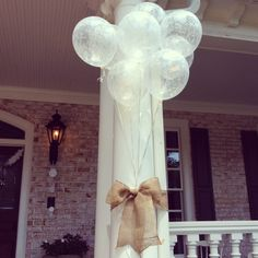 Cute bridal shower outdoor decor! Simple and beautiful! Burlap, ribbon and red balloons.