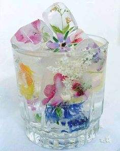 Wildflower ice cubes. Cute idea, but when they melt you have all these flowers in your drink...