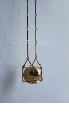 Geometric necklace. Gold CUBE NECKLACE with caged ball, skinny bar chain. Geometric jewelry  No.4. $63.00, via Etsy.