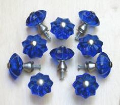 Cobalt blue star glass and satin nickel knobs.