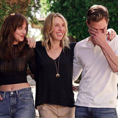 Jamie Dornan, Dakota Johnson, and Sam Taylor-Johnson are sexy as sin and silly too. Love this photo. One of my favorites. Jamie's hand on his face is beguiling!! 50 Shades of Christian and Ana