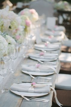 grey napkins, ivory ribbon and a pink flower.  Colored napkins are very expensive and elegant looking.
