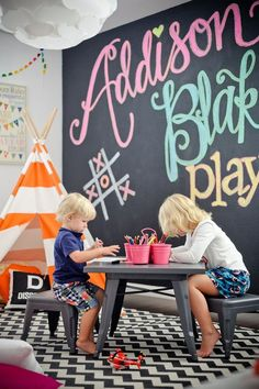 This colorful kids playroom boasts an amazing feature - a washable rug!