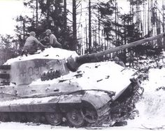 Tiger II from schwere SS-Panzer-Abteilung 506, abandoned near Villers-la-Bonne-Eau south of Bastogne. The position of the gun barrel, locked in the fully recoiled position, indicates that the crew sabotaged their Tiger before abandoning it. U. S. soldiers are of the 35th Infantry Division. The original wartime caption was in error…it wrongly placed this Tiger 'on the road from Bastogne to Houffalize'. Although this is not 30th Bulge territory I thought this a great photo of the mighty Tiger.