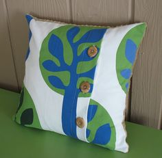 DIY button pillow--would look cute with striped fabric