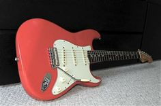 The Simon Neil Stratocaster® guitar puts Simon's own personal touch on a Squier® Classic Vibe series instrument. Based on his Fender® Custom Shop Time Machine™ '60s Stratocaster® guitar, features include an alder body finished in Fiesta Red, vintage-tint gloss maple neck, Simon's signature on the back of the headstock as well as the Biffy Clyro band logo on the front, 3-ply mint green pickguard, three custom vintage-style single-coil pickups utilizing a mix of alnico III & V magnets.