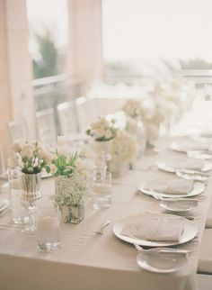 Feasting table all in white flowers and mercury glass by Flowers by Fudgie  #tablescapesphotography: lexia frank photography - lexiafrank.comRead More: http://stylemepretty.com/2013/09/16/sarasota-wedding-from-lexia-frank-photography/