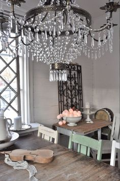 Inspiration - love the chandelier paired with the casual farm table.