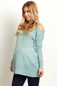This oh-so-stylish maternity sweater is the perfect transitional piece from winter into spring. We love the cutout shoulder detail that puts chic style in a long sleeve sweater. Style this maternity sweater with maternity jeans or over a maternity maxi dress for a complete ensemble.